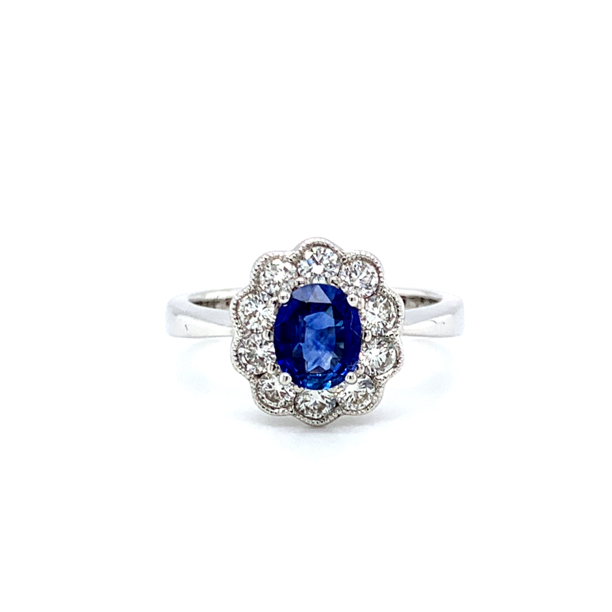 Poppy Oval Cut Blue Sapphire Halo Engagement Ring